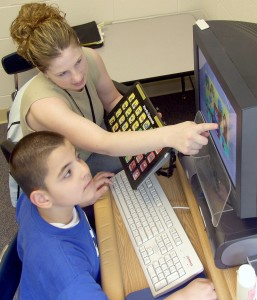 Speech Therapy with teacher and computer