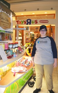 A Woods employee works at the Yellow Daffodil kiosk at the Oxford Valley Mall.