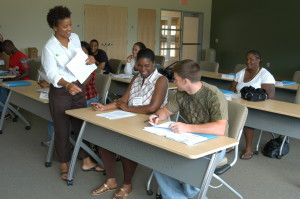 Employees fill out paperwork during a training session.