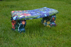 A mosaic bench made by the residents of Woods Services.