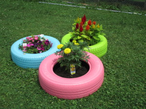 Painted tires hold a garden at Woods Services.