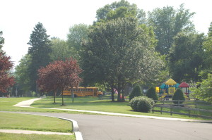 A school bus and playground on the campus of Woods Services.
