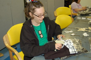 A Woods resident tags clothing at TWE.
