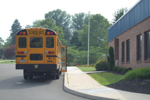 School bus in front of Gardner Education Center at Woods.